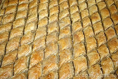 Huge baking tray full of rhombic Baklava