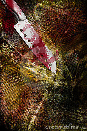 Huge bloody steel knife on filthy bloody clothing