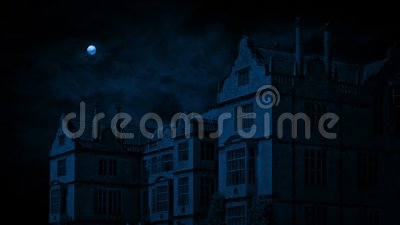 Country estate on windy night. Huge country house in the dark with a full moon above stock video