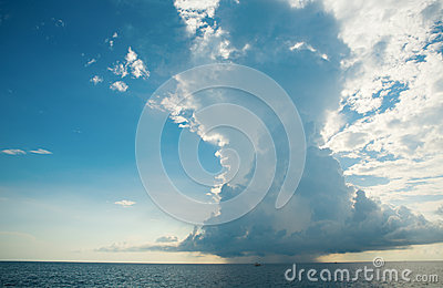Huge distant cloud with rain over the sea