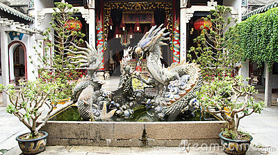 Huge dragon figure inside Chinese temple complex