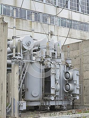 Huge industrial high-voltage substation power transformer on rails