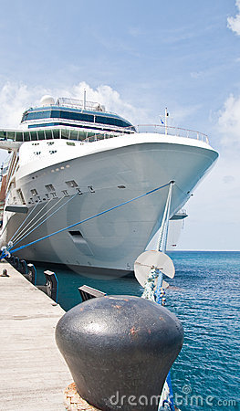 Huge Luxury Cruise Ship Tied to Black Bollard
