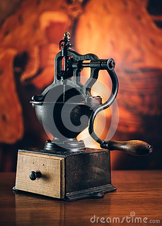 Free Huge Old Coffee Grinder On Wooden Table. Vintage Toned Royalty Free Stock Photography - 105516927