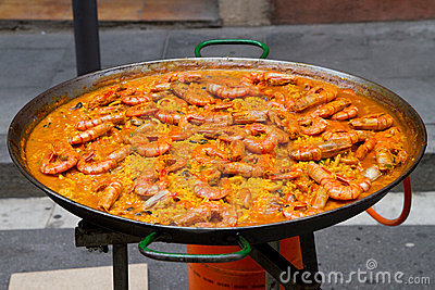 Huge shrimp paella in cooking pan