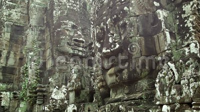 Huge stone faces on the walls of an ancient temple. Cambodia, Bayon. Video 1080p - Huge stone faces on the walls of an ancient temple. Cambodia, Bayon stock video