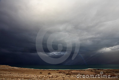 Huge thundercloud above an autumn field
