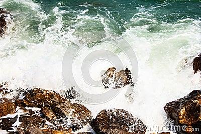 Huge waves crashing on the rocks
