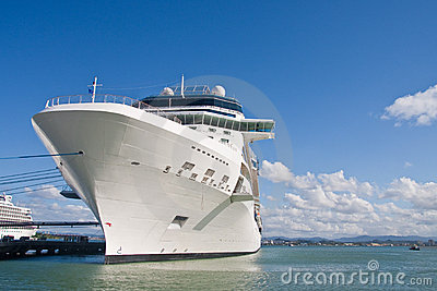 Huge White Cruise Ship Tied to Pier with Blue Rope