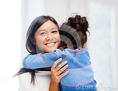 Hugging mother and daughter