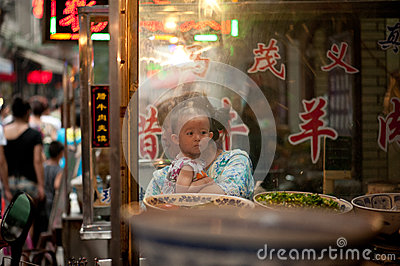 Hui child at the market on lively Muslim Street Editorial Stock Photo