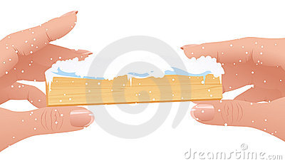 Human fingers holding Christmas frame