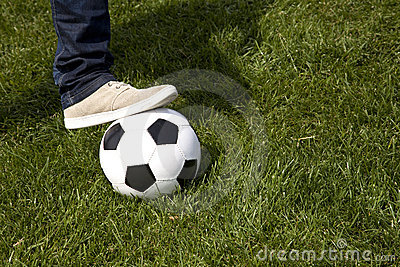 Human foot and a soccer ball