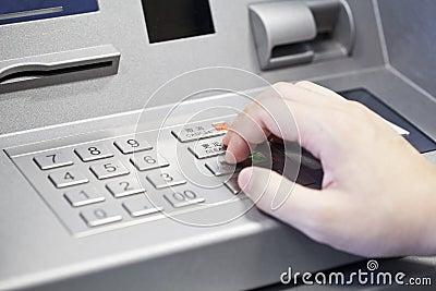 Human hand enter atm banking cash machine pin code