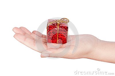 Human hand with a gift box