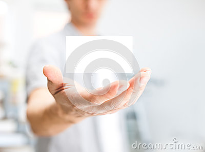 Human hand holding blank business card