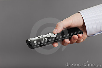Human hand holding tv channel remote control