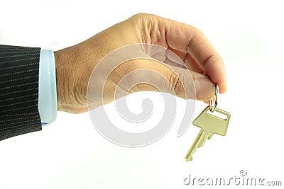 Human hand and key
