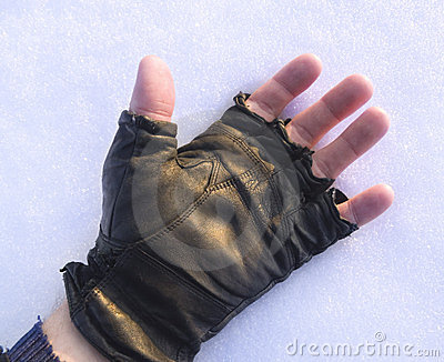 Human hand on the snow.