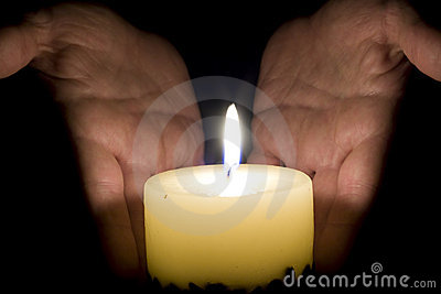 Human hands and candle light
