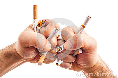 Human hands heatedly breaking cigarettes