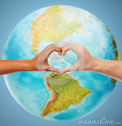 Free Human Hands Showing Heart Shape Over Earth Globe Royalty Free Stock Photography - 49716027