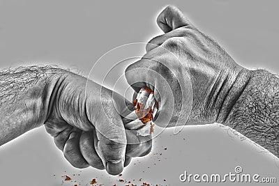 Human hands violently breaking cigarettes