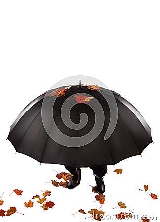 Human hiding under umbrella