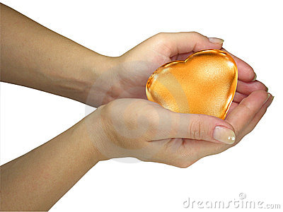 Human lady hands holding golden heart
