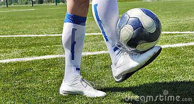 Human leg and soccer ball