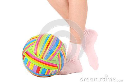 Human legs with a multicolored ball