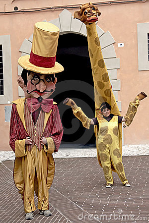 Human puppets performing at festival, Italy Editorial Image