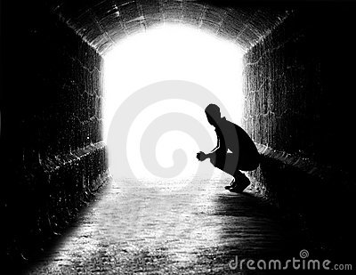 Human silhouette in back-lit in tunnel exit