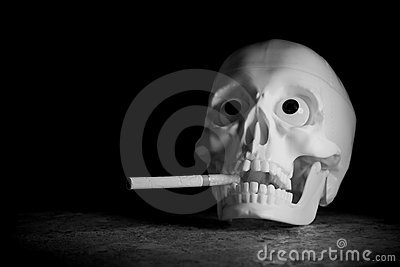 Human skull with cigarette
