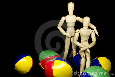 Humanoid couple hugging with juggling balls