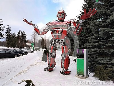 The humanoid metal funny robot the autoboat Red, is made of car spare parts, refuels gasoline, parts of body of the robot, Stock Photo