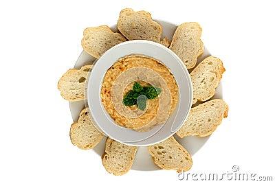 Hummus dip with bread slices