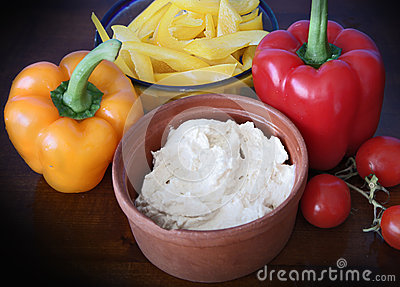 Hummus dip, peppers and tomatoes