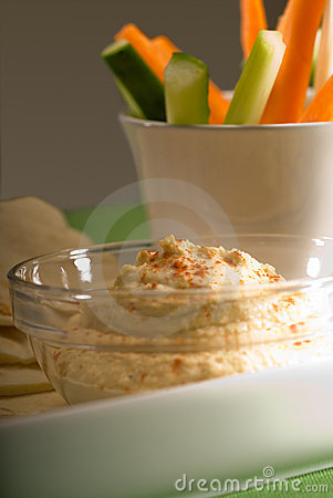 Hummus dip with pita bread and vegetable