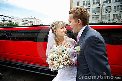 Humorous picture bride and groom on red limo