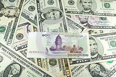 Hundred Cambodian Riel (KHR) on many dollars background