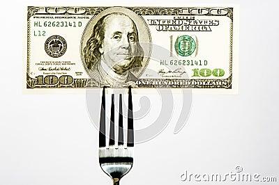 Hundred dollar bill on a fork