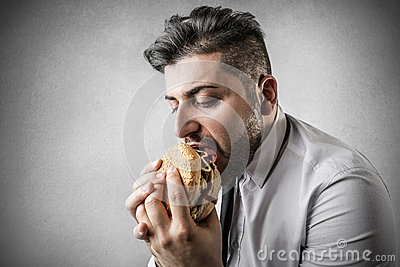 Hungry businessman during lunch break