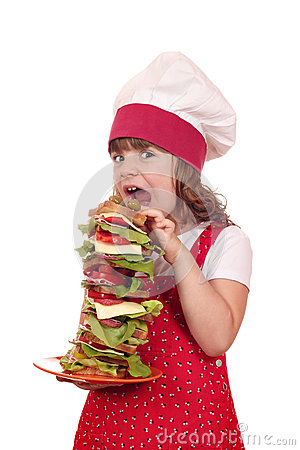 Free Hungry Little Girl Cook Eat Sandwich Stock Photo - 34268810