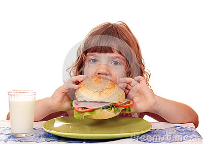 Hungry little girl eat