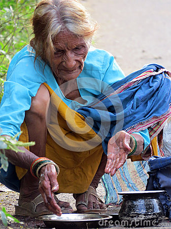 Hungry Old Woman Editorial Photo