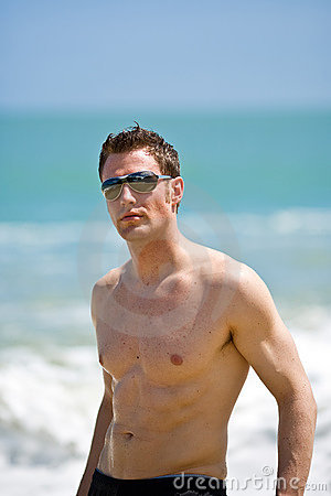 hunk at the beach with shades