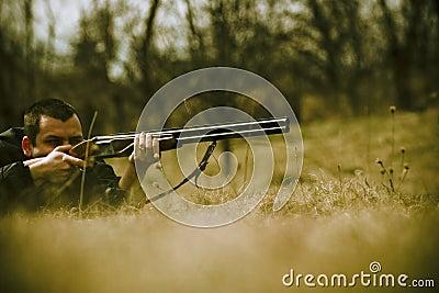 Hunter Aiming Shotgun