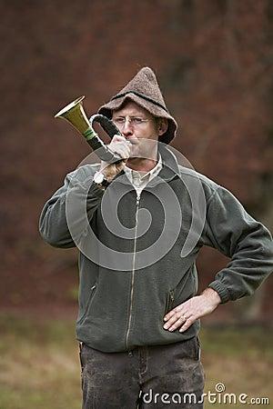 Hunter blowing horn