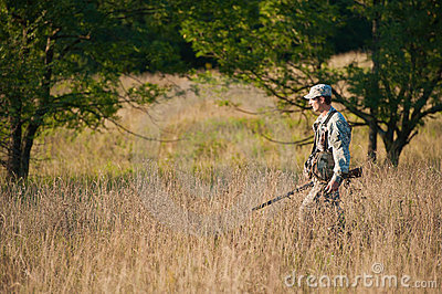 Hunter in countryside